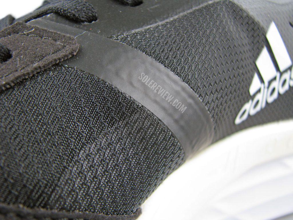 The upper overlays of the adidas adizero Boston 10.